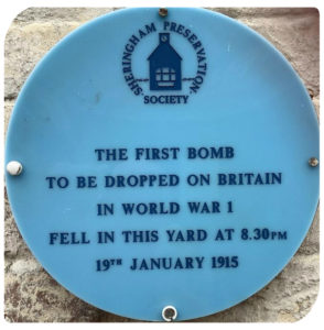 Blue plaque commemorating the first bomb dropped on Britain in World War 1 which was dropped on Sheringham